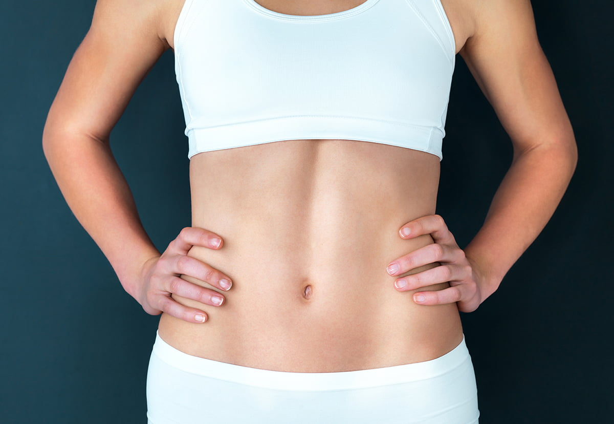 woman with sculpted, lean abdominals coolsculpting vs emsculpt for abdominal sculpting