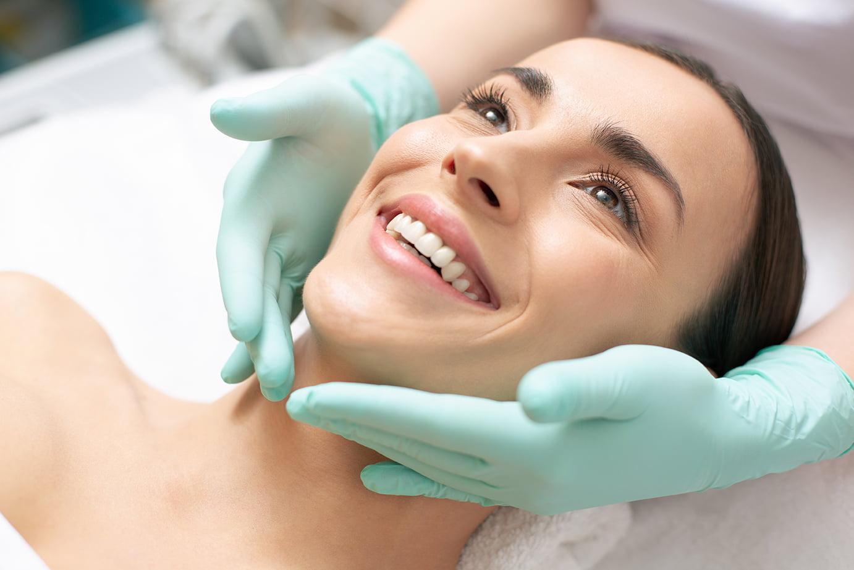 Young woman receiving facial treatment