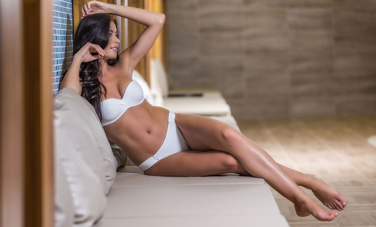 Woman Enjoys Results from Non Surgical Fat CoolSculpting Procedures