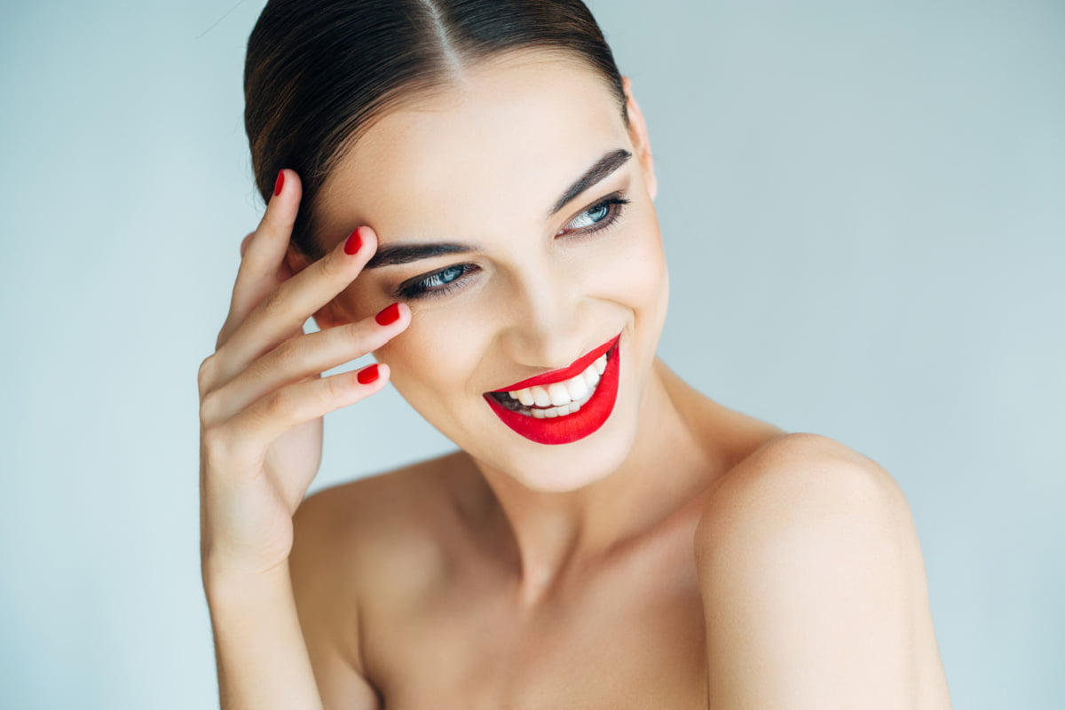 Smiling Woman Enjoys Beautiful Skin After CO2 Laser Treatment