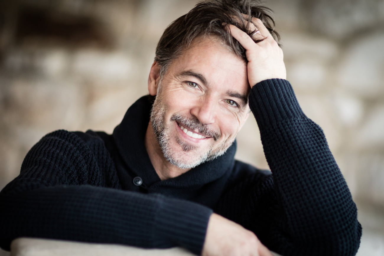 Man Smiling After Hair Restoration Treatment Plan at Kalos Medical Spa in Fort Worth